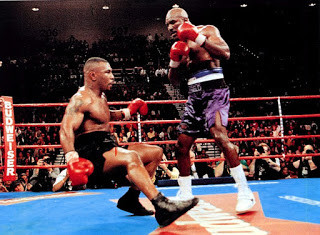 Tyson on his way down after a left hook counter