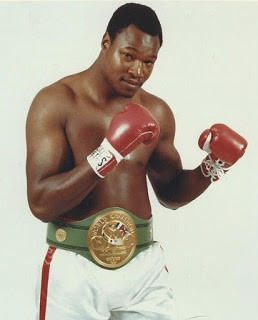 The WBC title was in safe hands with Larry  Holmes, but the WBA crown wasn't...