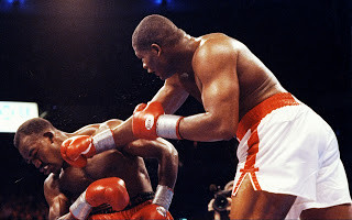 Bowe landing a right against Evander Holyfield