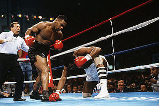 Spinks put down for the first time in his career by a right to the body