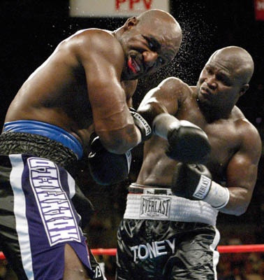 Holyfield takes a right from James Toney