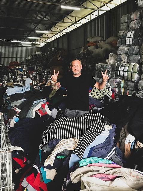 Preloed Kilo's Wayn handpicking vintage clothing for our kilo sale