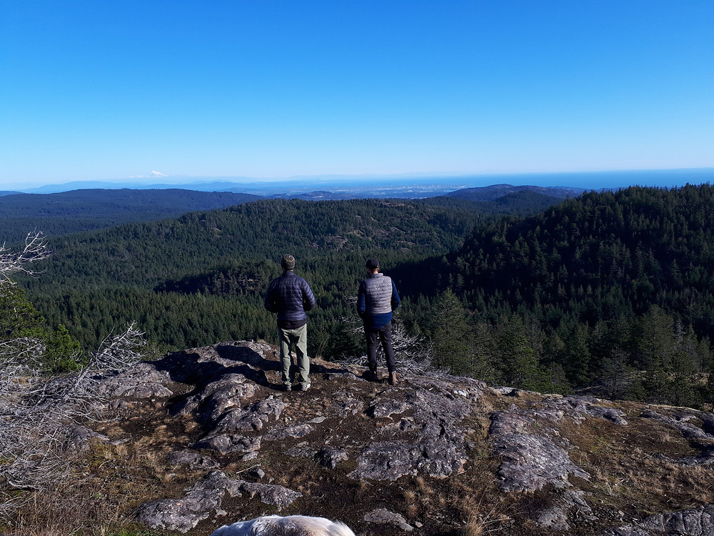 Dave and Michael look at the Juan de Fuca straight from on a mountain