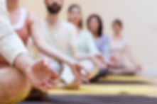 group-of-people-doing-meditation-on-exer