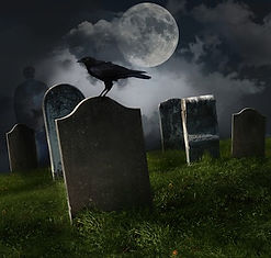 Graveyard at full moon with raven on gravestone