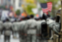 us-armed-serviceman-waves-american-flag-