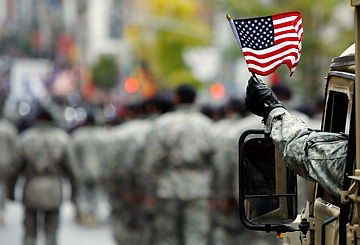 us-armed-serviceman-waves-american-flag-