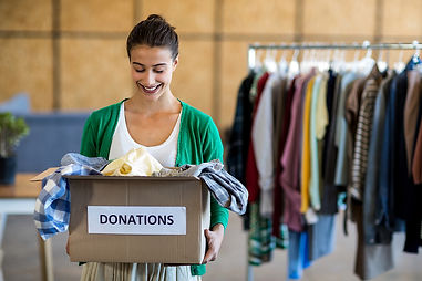 Young-woman-with-donation-box.jpg