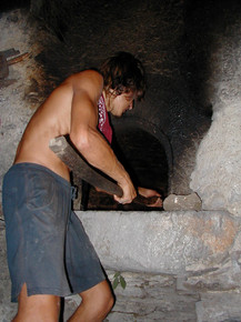 Nicola works the oven