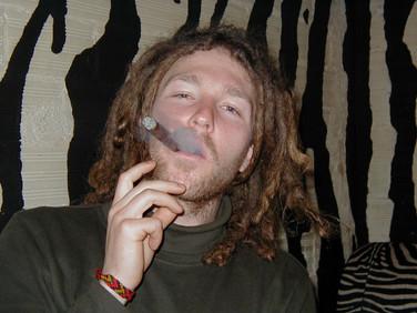 Darryl smoking a cigar