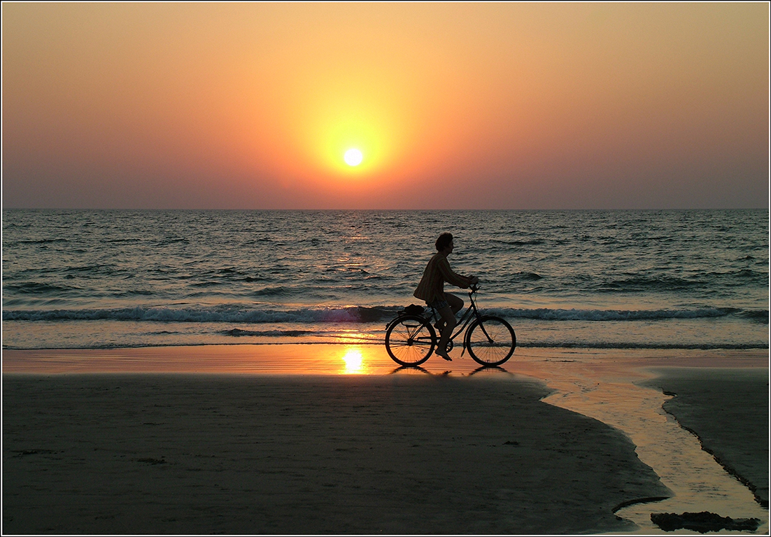 Cyclist at Sunset, Goa, India