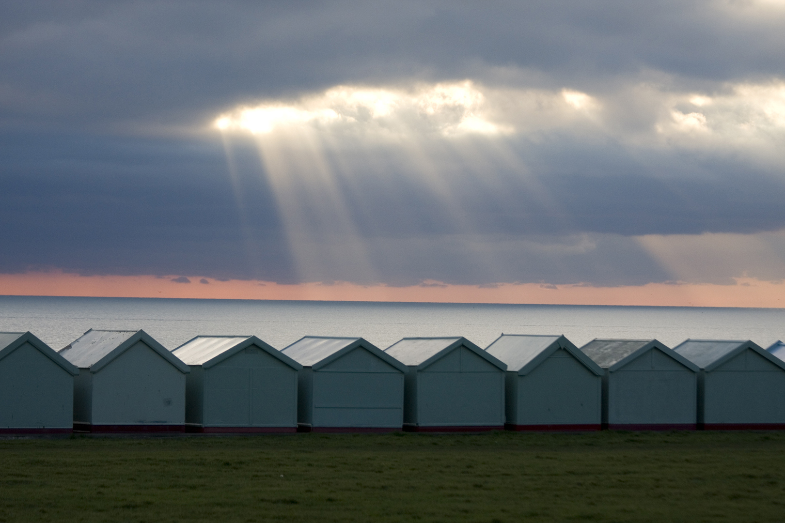 Hove Beach Huts with Sun Rays