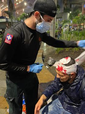 Hatzalah student attending patient