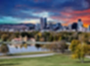 Denver skyline across city park in autum