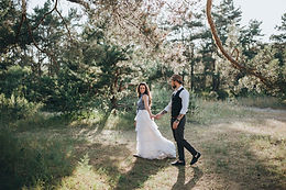 Bride and groom at boho wedding venue