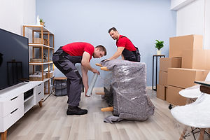 two-movers-wrapping-a-couch.jpeg
