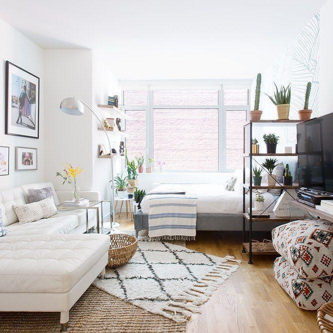 Studio contemporâneo com dormitório de solteiro.