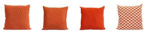 Texturas de coral e laranja vivo nas almofadas da Macadâmia.