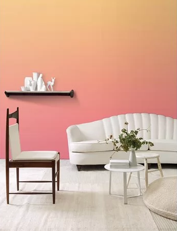 O papel de parede da Branco faz um degradê entre o rosado e o laranja, intermediando o coral.