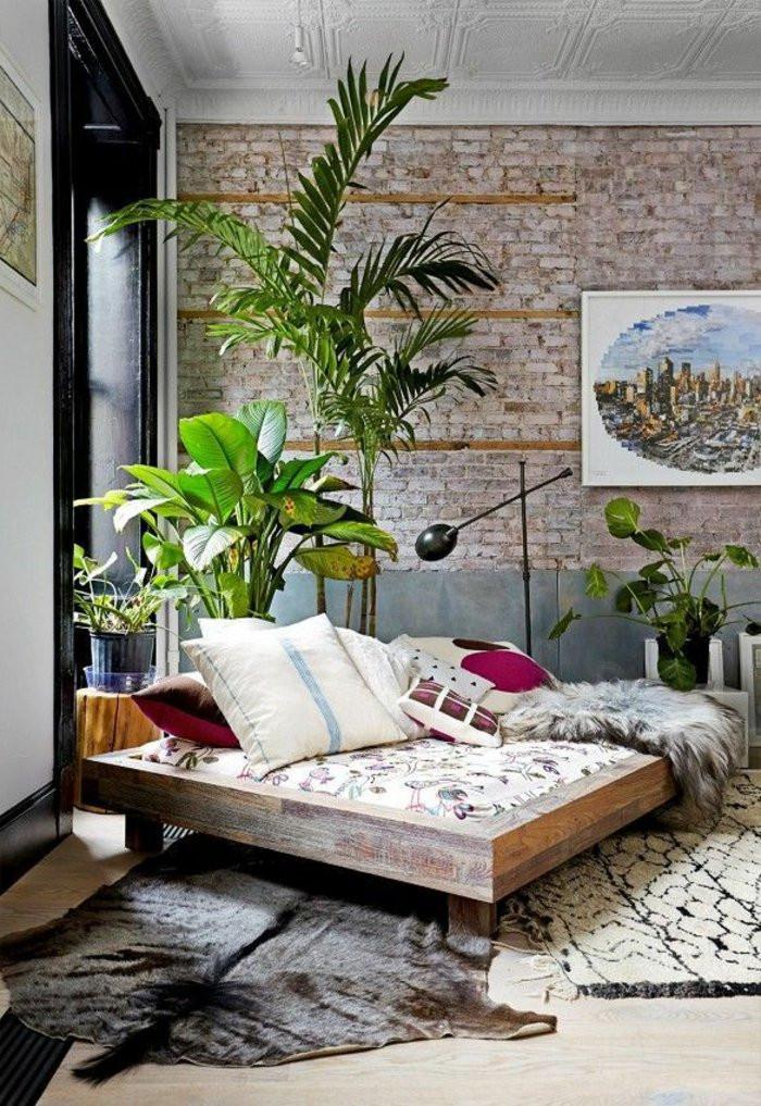 Dormitório rústico com plantas