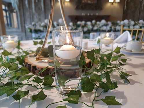 Four floating candles and garlands for base of centrepieces