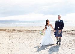 Bride and groom on beach[2090]
