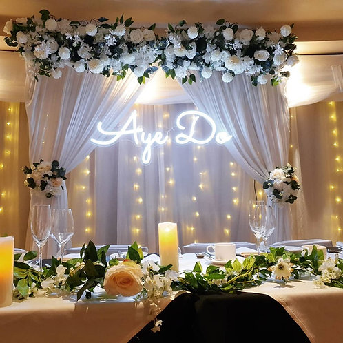 Rectangular arch backdrop with curtains and floral runner
