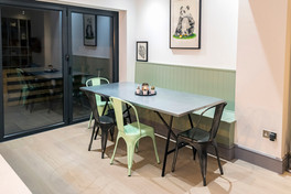 Dining area, bespoke build, wood panelling, sliding doors, bi-fold doors, london, surrey, renovation