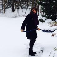 Esther shoveling snow