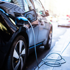 Charging modern electric car on the stre