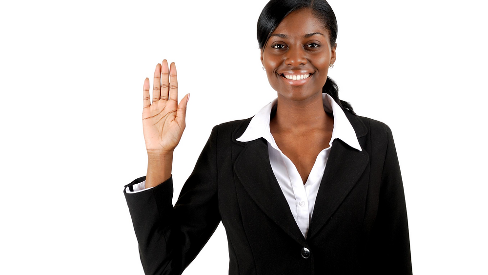 Woman in suit raising right hand - The Hidden Power of Oaths