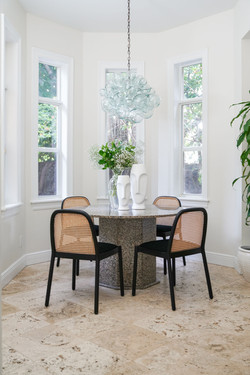 Light and airy breakfast nook with marble table