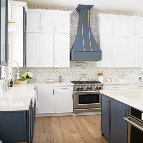 Modern white kitchen with custom blue decorative hood.jpg