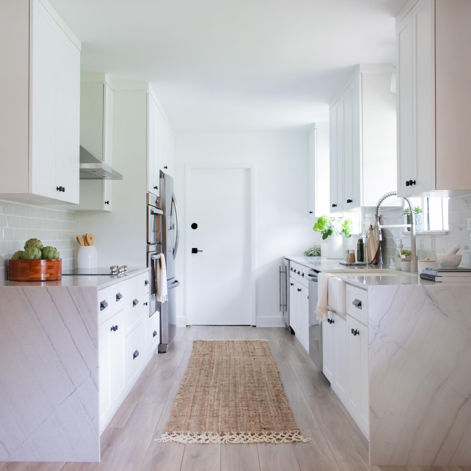 Modern bright white galley style kitchen