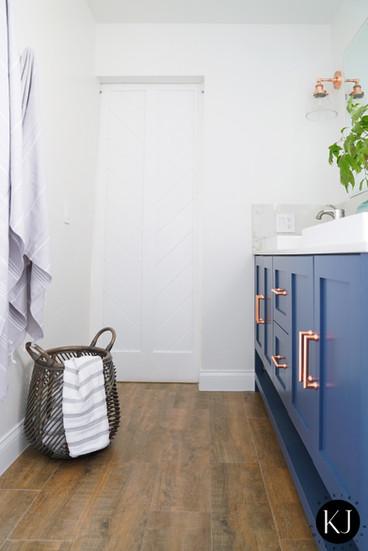 Modern farmhouse master bathroom with barn door designed by KJ Design Collective