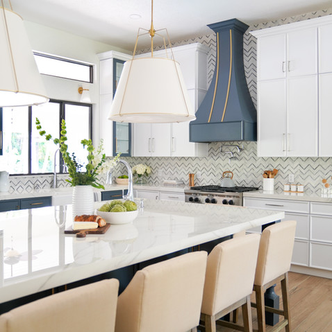 Large transitional modern kitchen with white cabinets and blue decorative vent hood