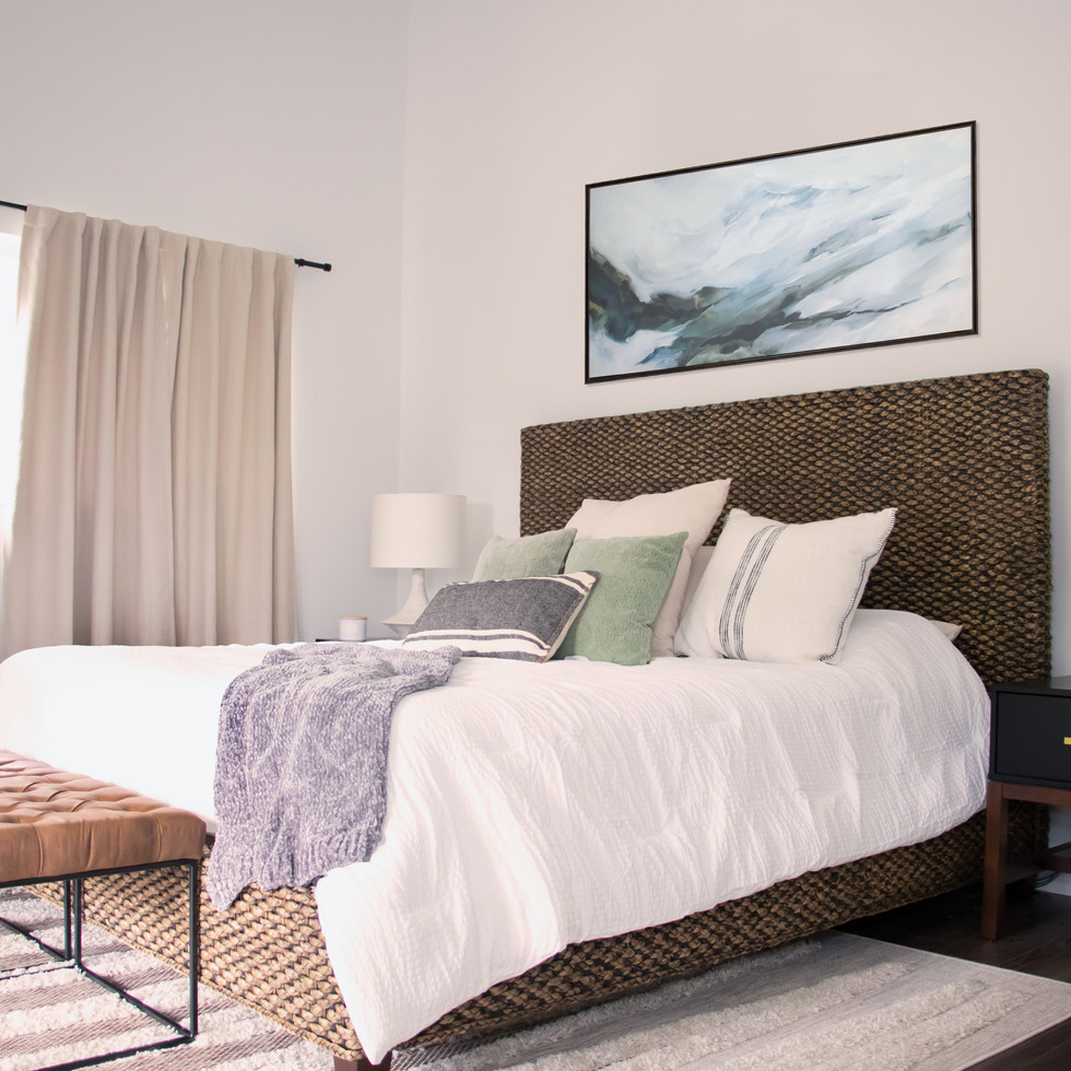 Modern master bedroom retreat with a worldly flair. Designed by KJ Design Collective.