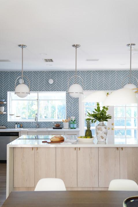 Miami Modern Kitchen with Bold Blue Backsplash
