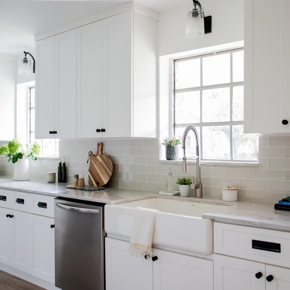 Modern bright white galley style kitchen designed by Miami based interior design studio KJ Design Collective