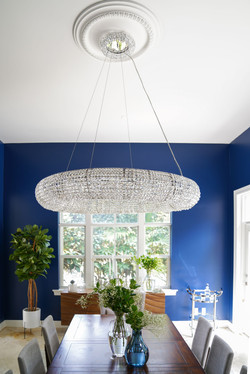 Modern and glam large dining room with chandelier