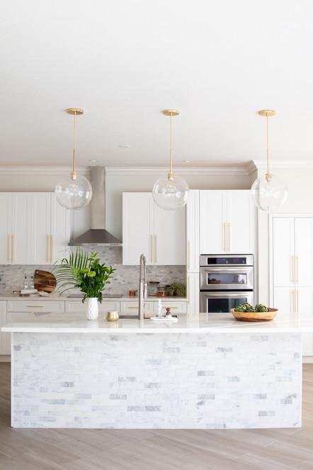 Modern white kitchen with brass hardware designed by KJ Design Collective
