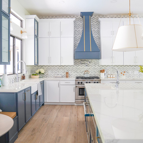 Large white kitchen with blue accents