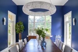 Modern and glam large blue dining room with chandelier