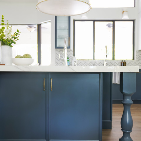 Transitional Kitchen with custom blue island