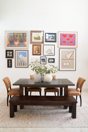 Modern and electic dining room with gallery wall