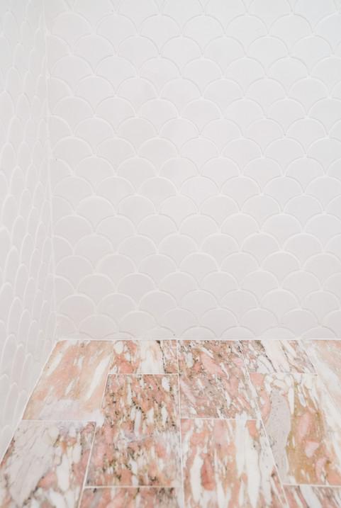 Modern feminine kids bathroom with pink tile