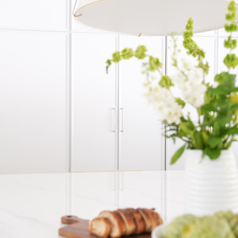 White kitchen with porcelain counter tops