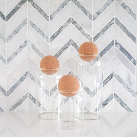 Transitional white kitchen with chevron mosaic backsplash