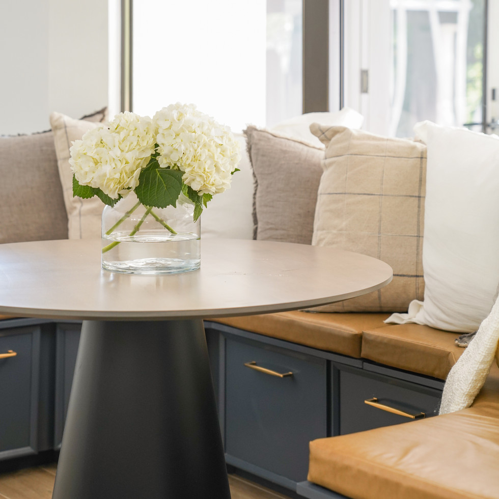 Transitional white kitchen with custom breakfast nook