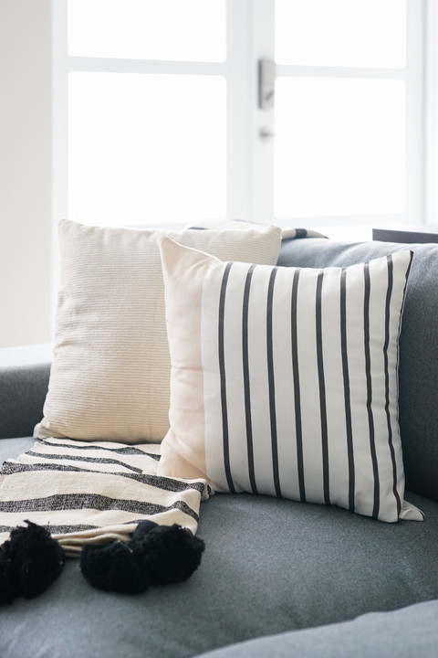 Accent pillows in casual modern living room by KJ Design Collective